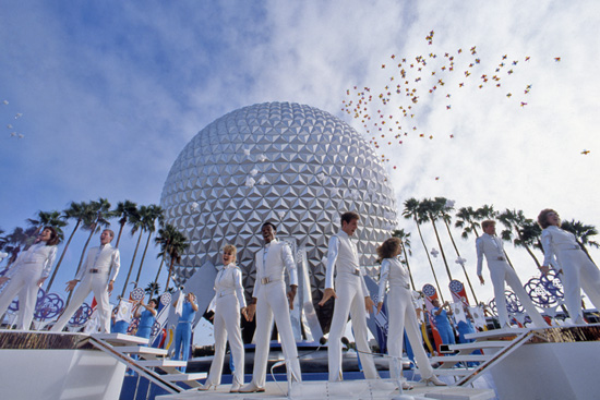 Dancers arranged in white for Epcot's opening under Spaceship Earth