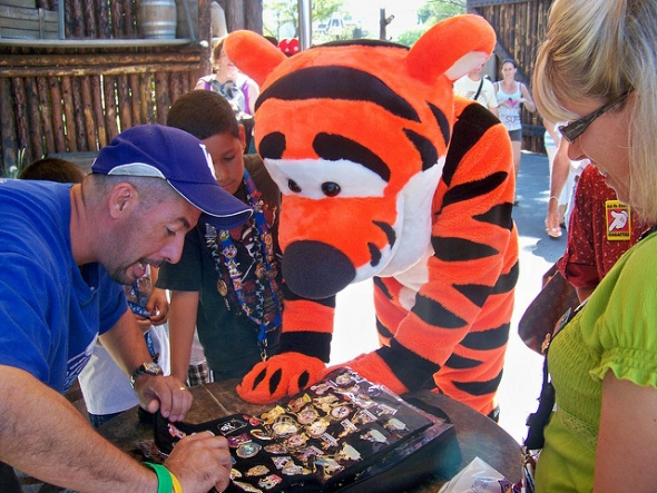 Tigger checking out trading pins with guest