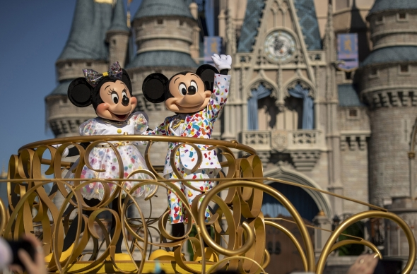Minnie and Mickey in front of castle