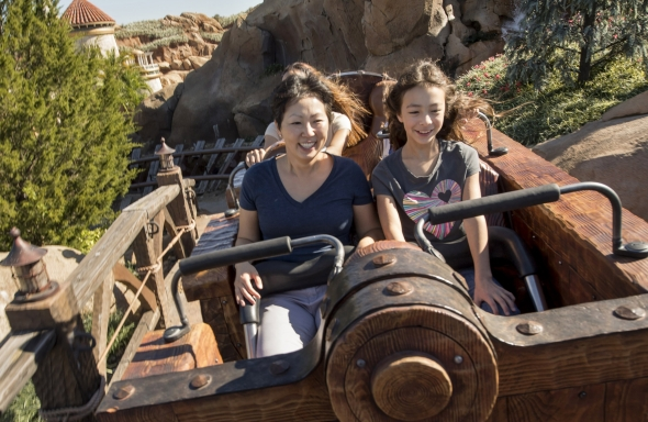 Girl from Modern Family and mother on Seven Dwarves Mine Train