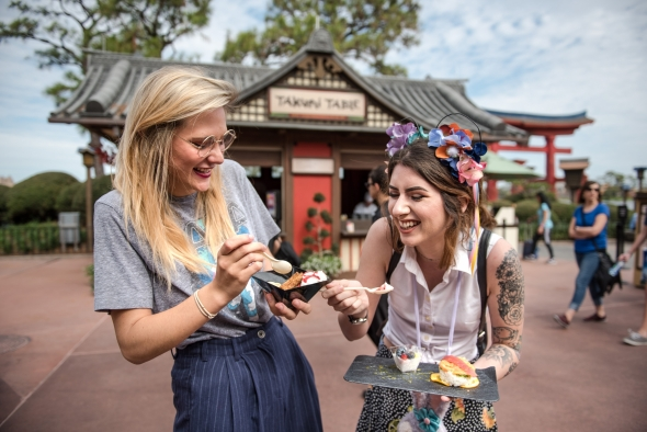 Girls laughing while eating at Epcot Festival of the Arts