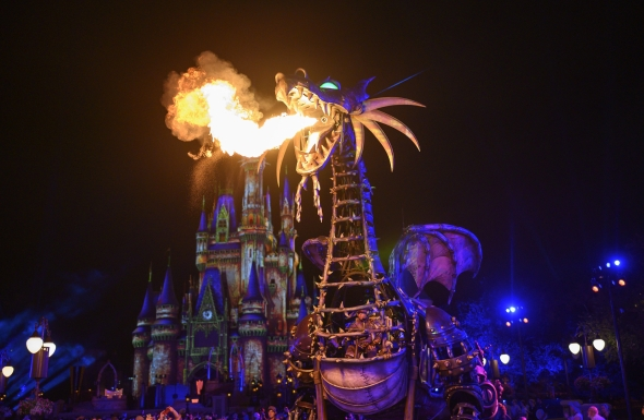 Malificent dragon blowing fire at night