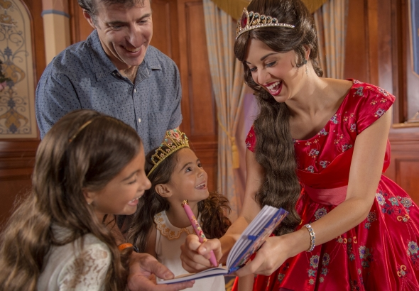 Elena of Avalor signing autographs