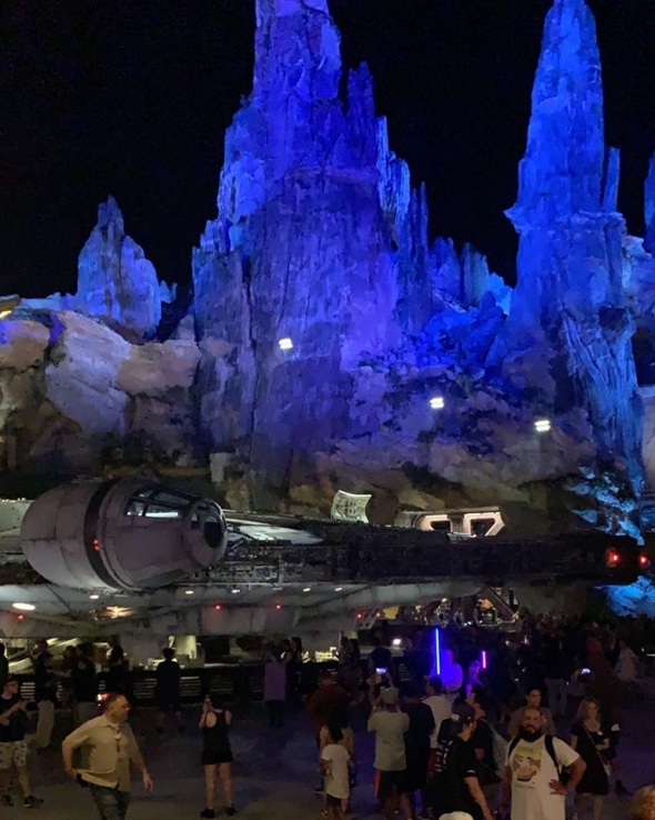 Millennium Falcon before dawn surrounded by guests