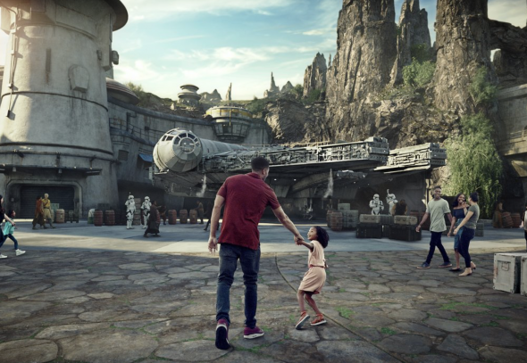 Girl and father running into Galaxy's Edge