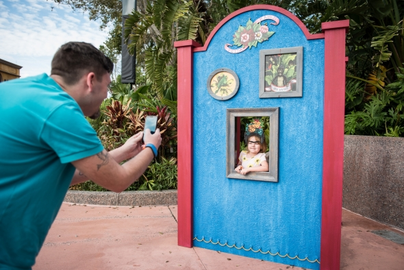 Little Girl taking picture at Frida Kahlo Photopass