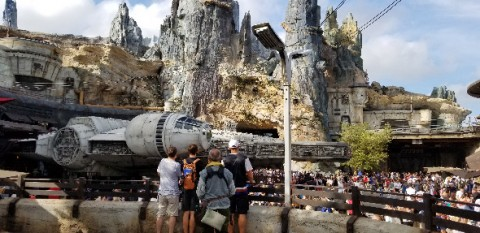 Crowds swarming around Millennium Falcon