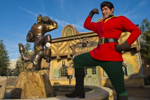 Gaston posing next to his statue