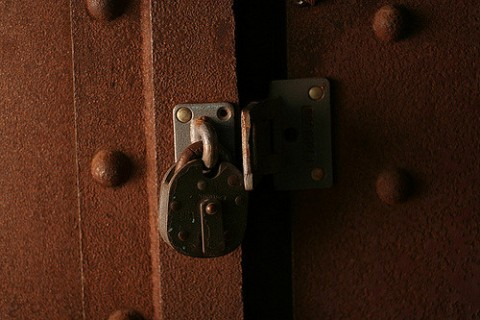 Rusty lock on a steel door
