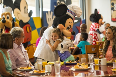 Chef Mickey giving a hug