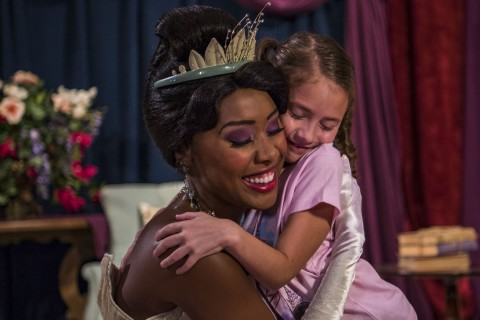 Tiana hugging very happy little girl