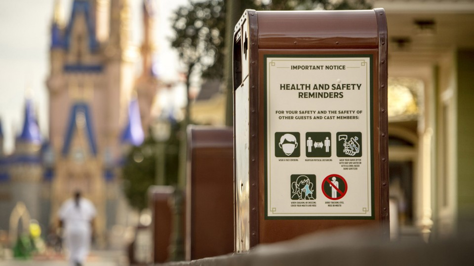 Health and safety warnings on side of Disney trash can