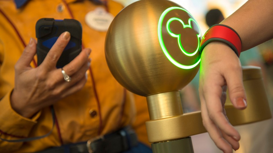 MagicBand being tapped to Mickey Mouse sensor in line