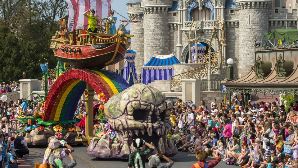 Peter Pan float for Festival of Fantasy parade surrounded by crowds